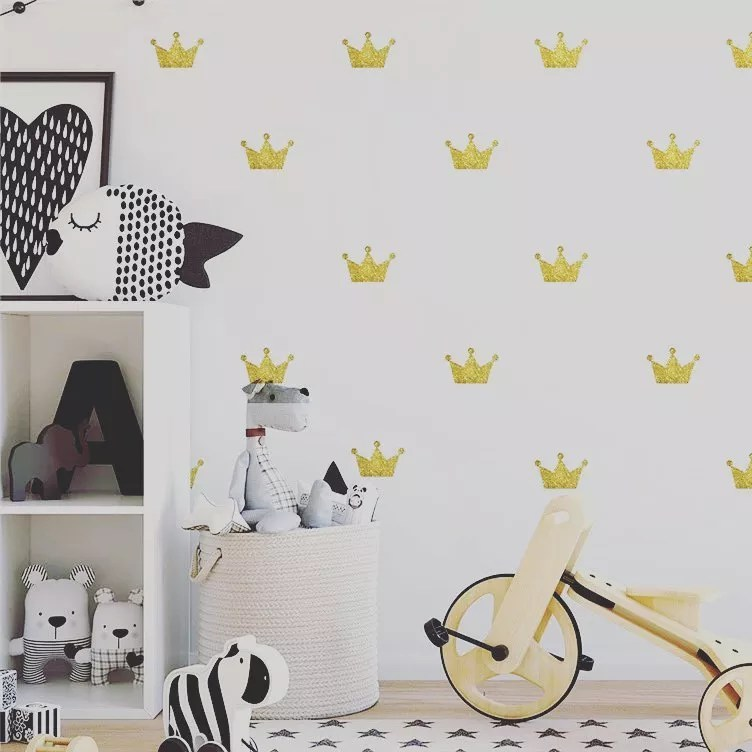 Yellow crown decals on white wall in kids room. Photo by Instagram user @superwallart