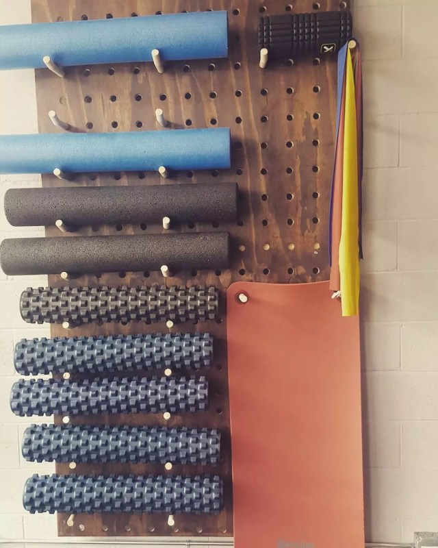 DIY pegboard for gym equipment. Photo by Instagram user @pptchicago