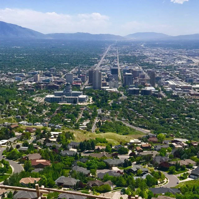 Aerial view of downtown Salt Lake City with mountains in the distance. Photo by Instagram user @real_estate_jace