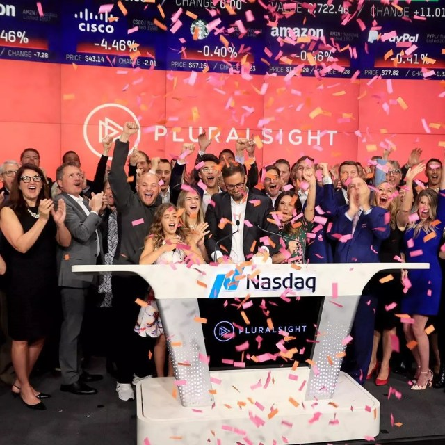 A group of people ring the bell for the Nasdaq as confetti falls. Photo by Instagram user @siliconslopes