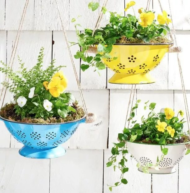Yellow and blue colander planters hanging. Photo by Instagram user @countrylivingmag