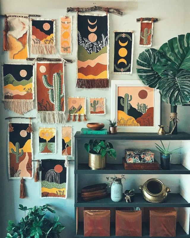 small handmade tapestries hanging on apartment wall photo by Instagram user @graphicolier