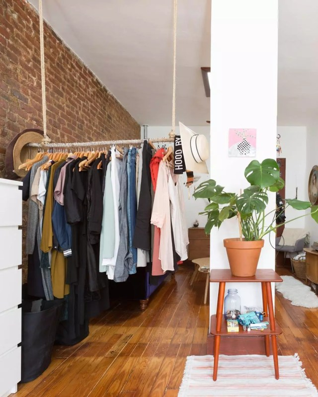 apartment space using a hanging closet for clothes storage photo by Instagram user @apartmenttherapy