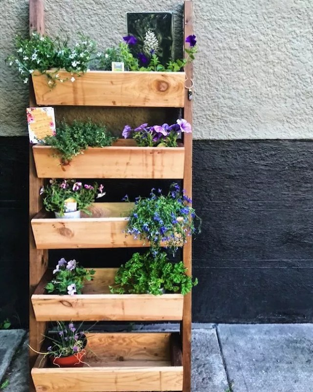 Wooden ladder planter with purple flowers. Photo by Instagram user @_jessfink