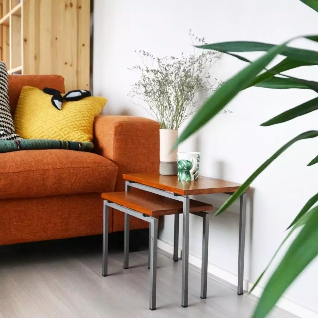 Nesting tables in living room for space-saving. Photo by Instagram user @indehut