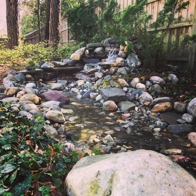 Small rock waterfall in a backyard. Photo by Instagram user @creativecascades