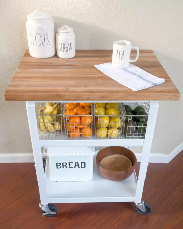Small rolling kitchen cart for small apartment use. Photo by Instagram user @bloomsandboxwood