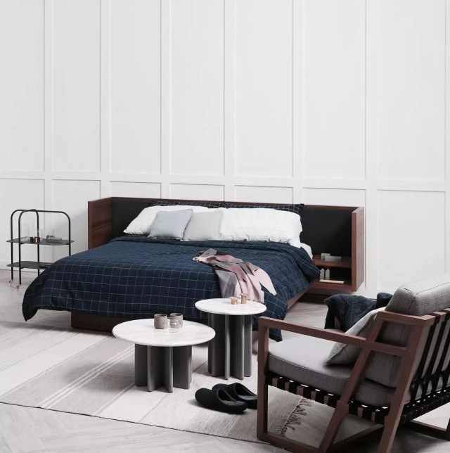 Studio apartment bed with headboard storage. Photo by Instagram user @jottergoods