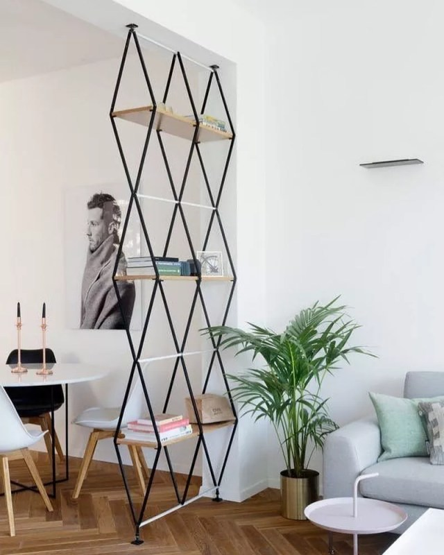 Open room divider with storage shelves for studio apartment. Photo by Instagram user @_metals