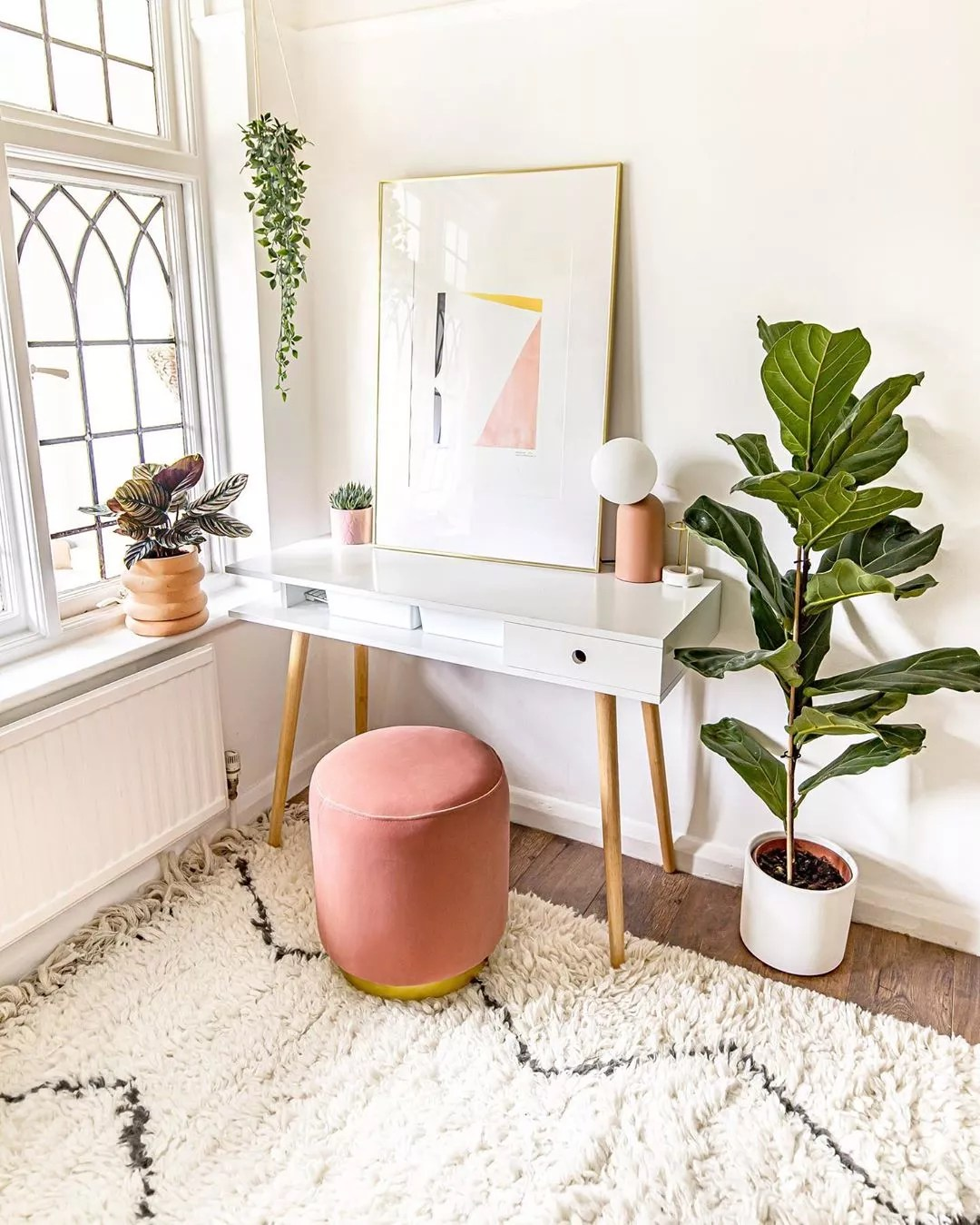modern home office with stool seat and plants placed around photo by Instagram user @homewithkelsey