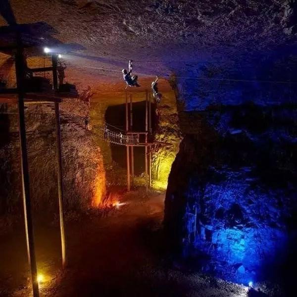 Man slides across zipline in underground adventure park at Louisville Mega Cavern. Photo by Instagram user @louisville_megacavern