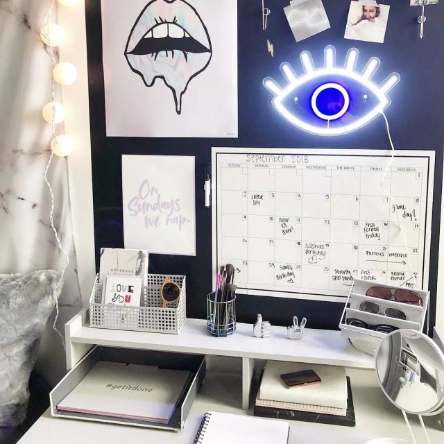 Dorm room wall with calendar, drawings, photos, and more. Photo by Instagram user @wallpops