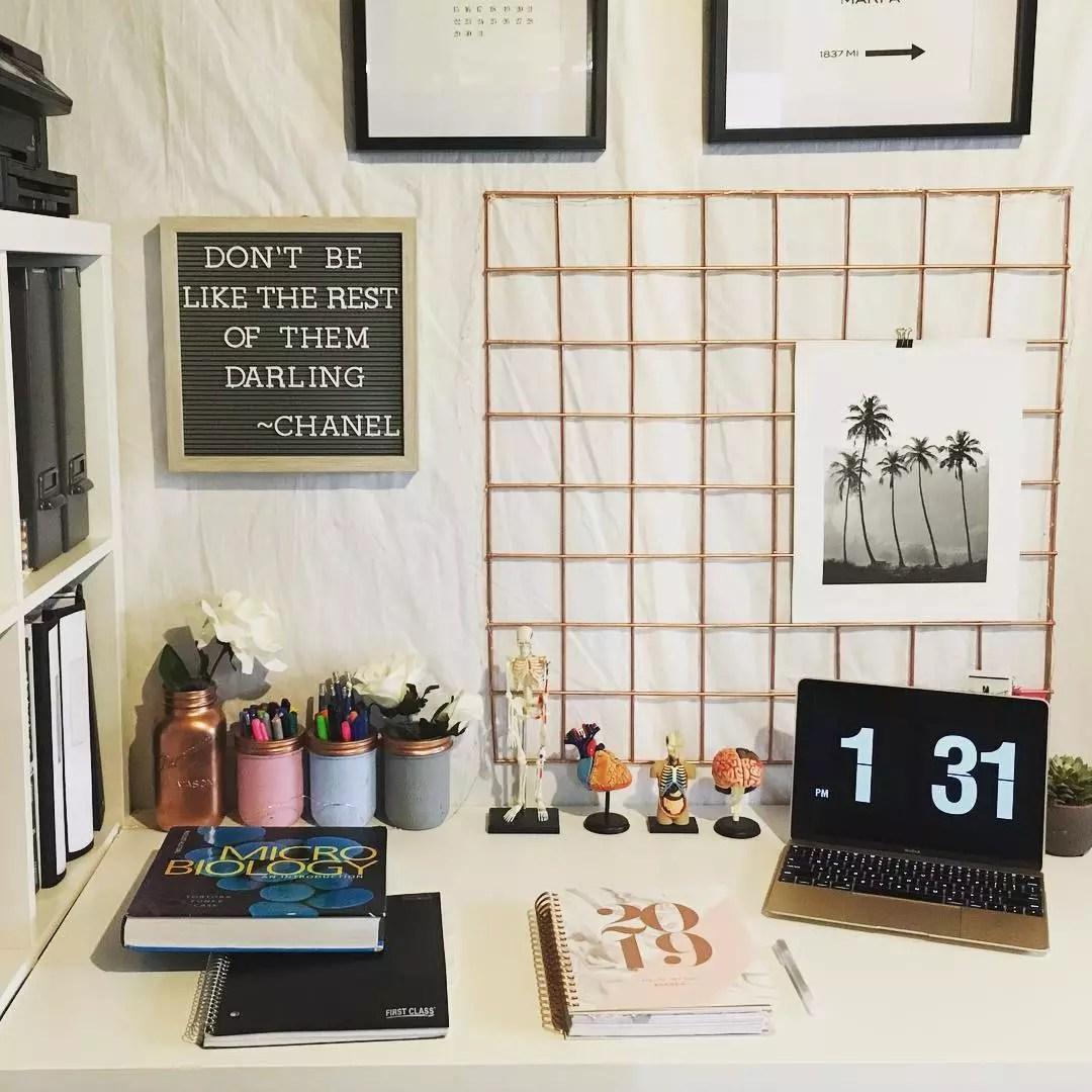 Dorm Room Desk with Laptop and Books. Photo by Instagram user @dayofanursingstudent