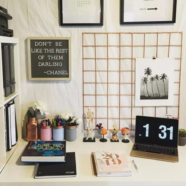 Dorm Room Desk with Laptop and Books. Photo by Instagram user @dayofanursingstudent