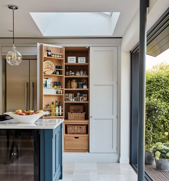 Built-in hidden pantry in kitchen. Photo by Instagram user @tomhowleykitchens