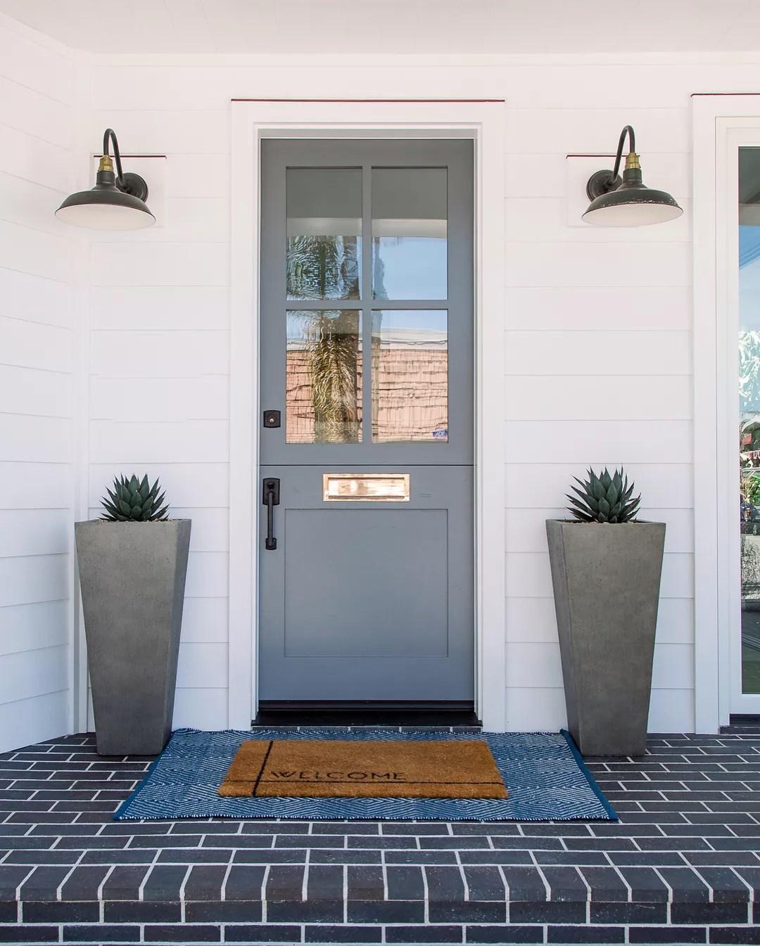 Gray front door. Photo by Instagram user @vlentine