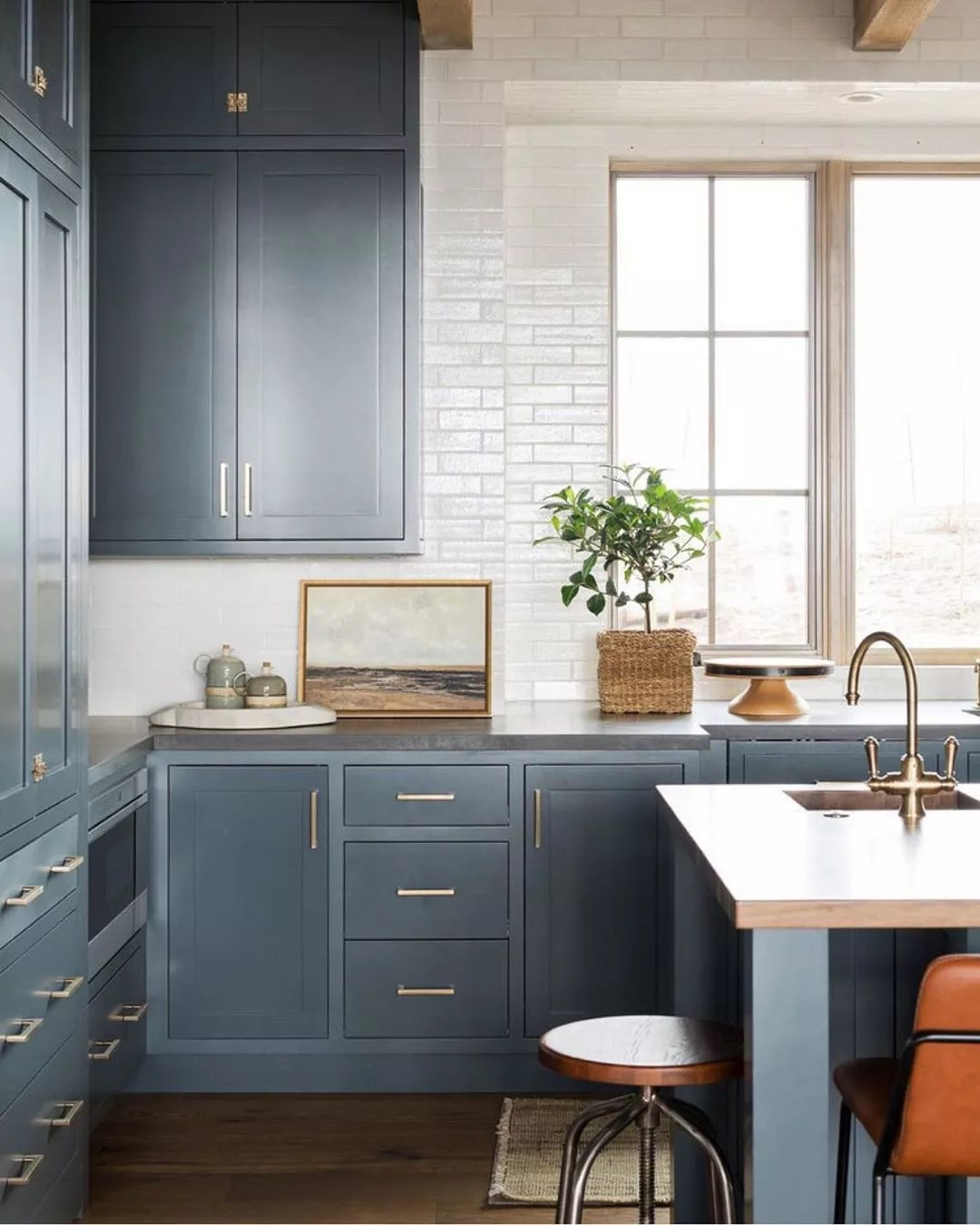Modern kitchen with blue cabinets. Photo by Instagram user @studiomcgee