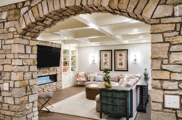 large stone archway leading to another basement area photo by Instagram user @manorbrook