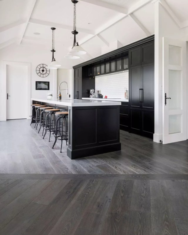 gray flooring in a basement with a full counter and bar photo by Instagram user @forteflooring