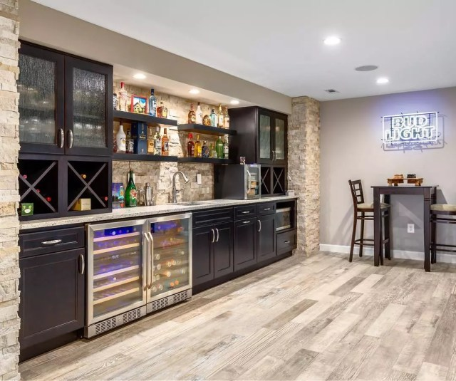 basement with full wet bar with cabinets and fridges photo by Instagram user @kbfbyaudicontractors