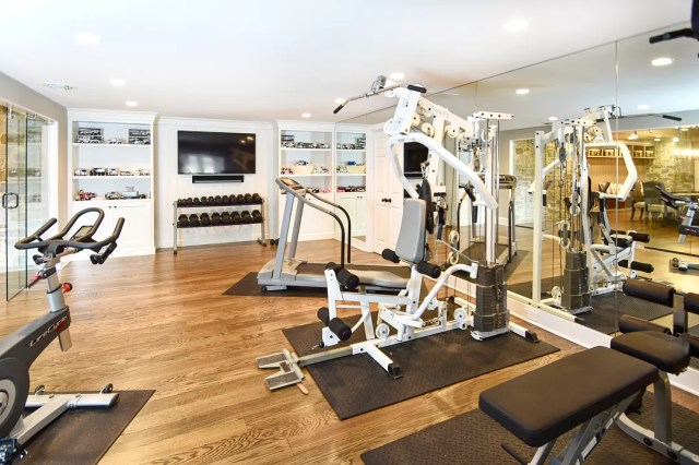 home gym space with weights and mirrors photo by Instagram user @gardner.fox