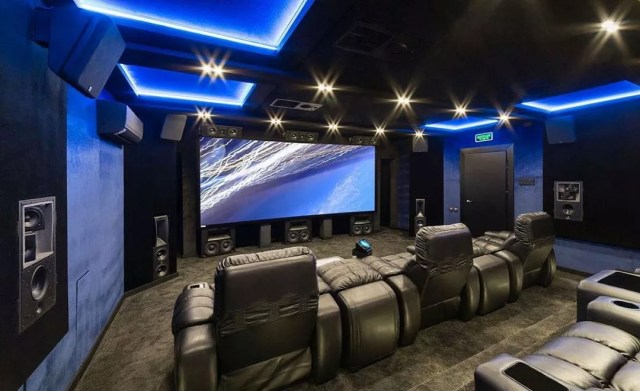 home theater space with nice reclining chairs and projector screen photo by Instagram user @woodys_soundup