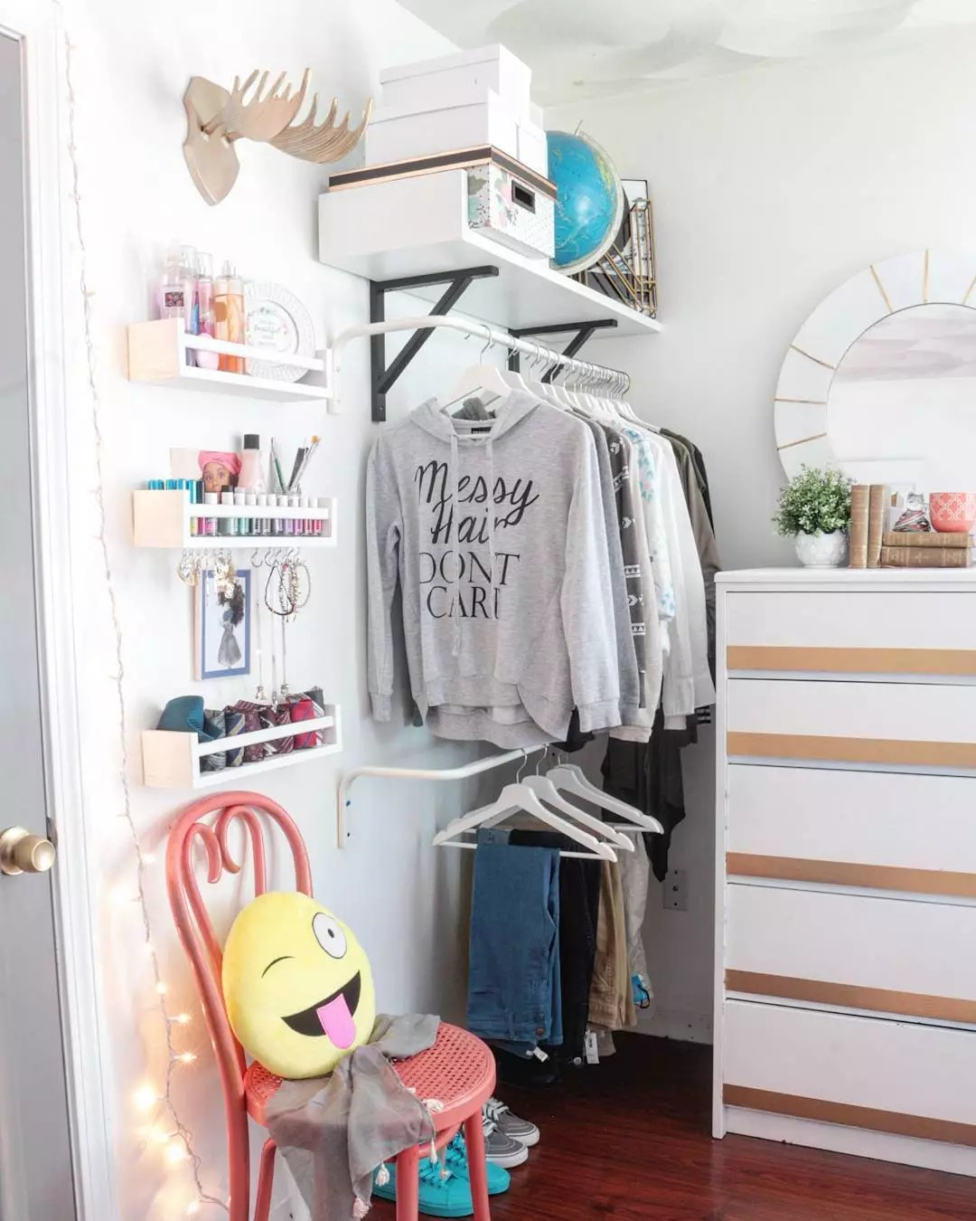 Bedroom with Vertical Storage, Including Hanging Shelves. Photo by Instagram user @madebycarli