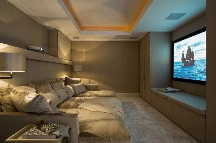 Basement Movie Room with Large Couch and Projector Screen Wall. Photo by Instagram user @improvenet