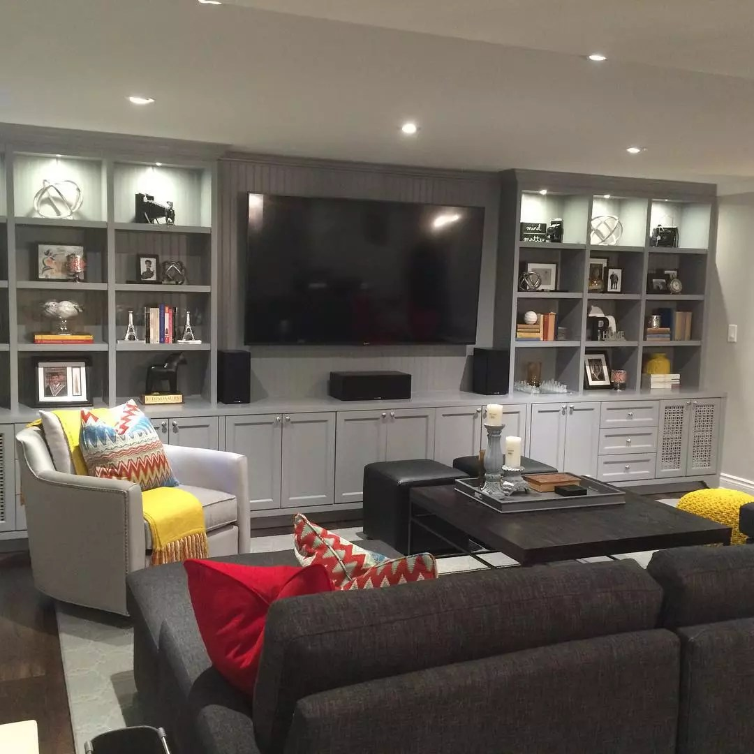 Basement Family Room with TV and Built In Shelves on the Wall. Photo by Instagram user @janelockhartdesign