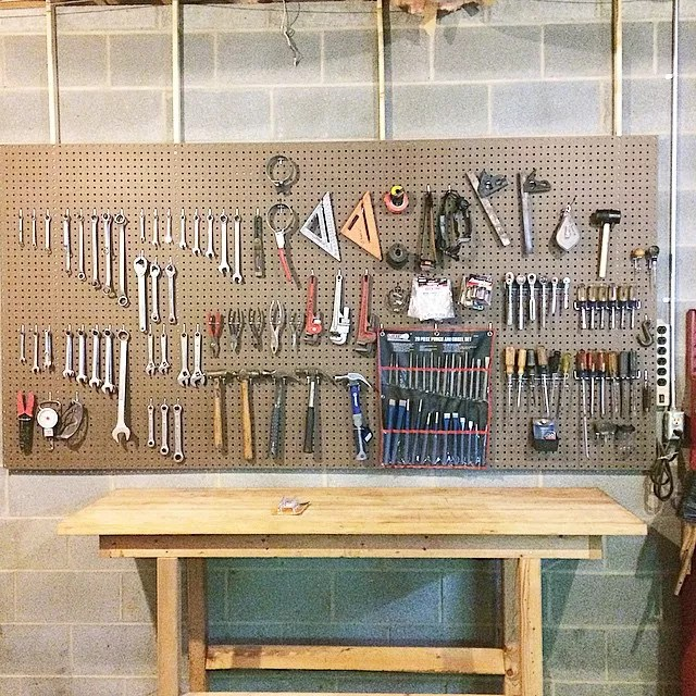 Basement Workshop Space with Pegboard to Hold Tools on the Wall. Photo by Instagram user @thejenniferburnham