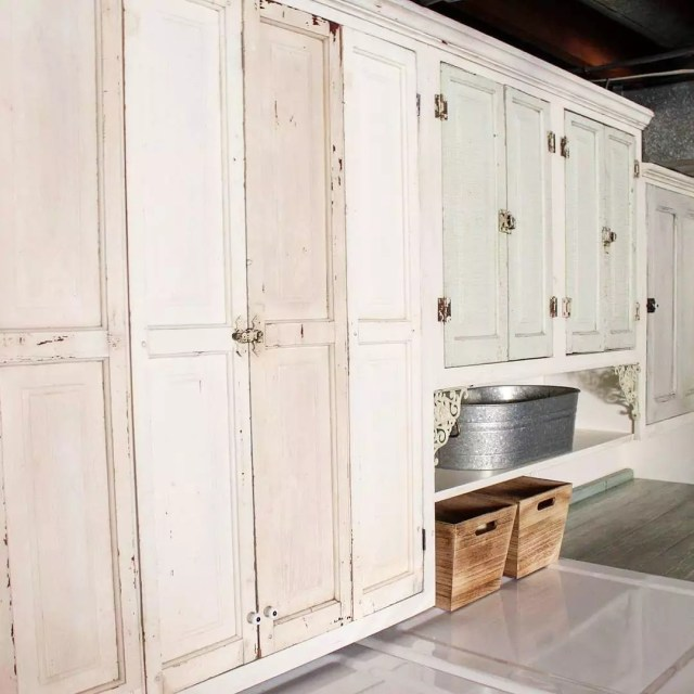 Old Kitchen Cabinets Reinstalled in Basement for Storage. Photo by Instagram user @cjperiwinkle