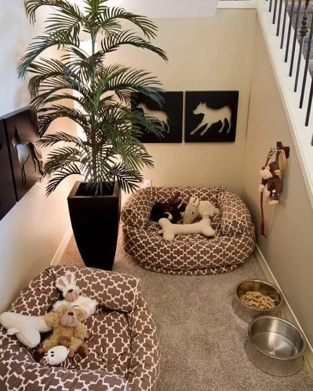 Dog Beds, Bowls, and Leashes in Nook by Stairs. Photo by Instagram user @trending_decor