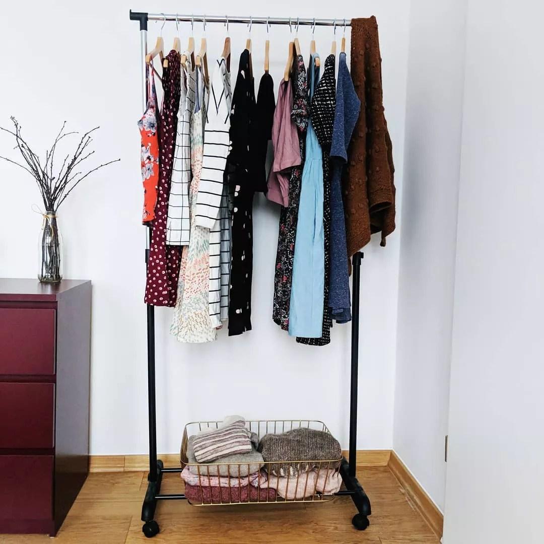 Capsule wardrobe on hanging rack. Photo by Instagram user @sopranoknits