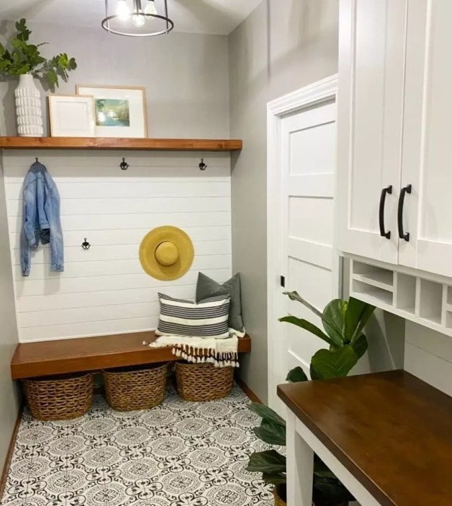 Mudroom with floating shelves. Photo by Instagram user @n.c.design316
