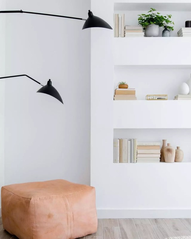 Recessed shelves in living room. Photo by Instagram user @thehabitatcollective