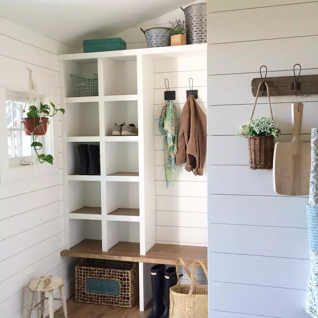 Shoe cubbies in mudroom. Photo by Instagram user @singlesilofarmhouse