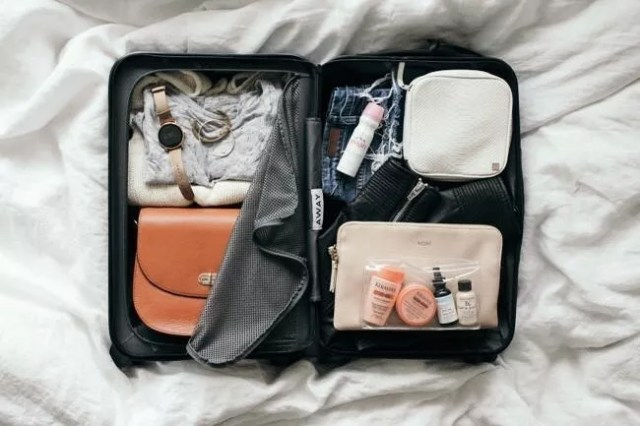 Suitcase with minimalist packing. Photo by Instagram user @youliveoncevacations
