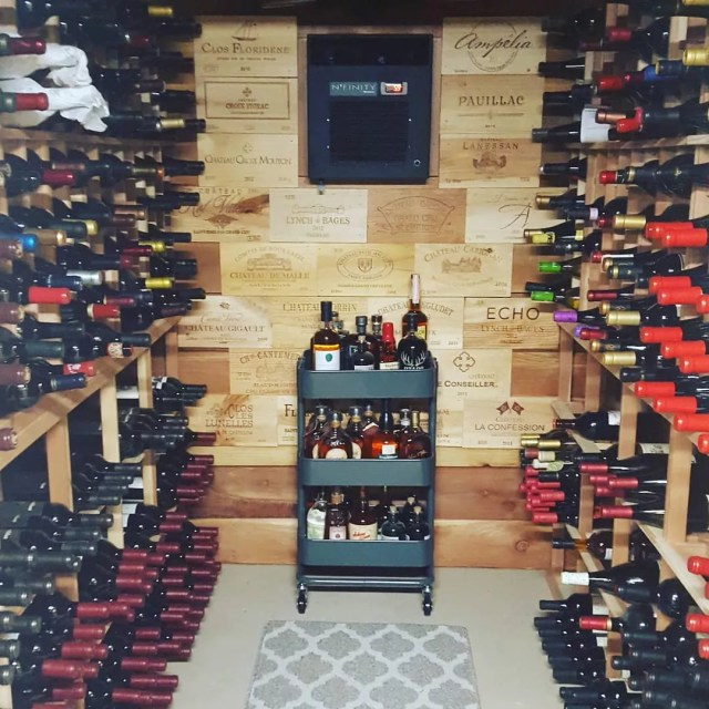 Wine Room with Walls Made out of Old Wine Boxes. Photo by Instagram user @philevans83