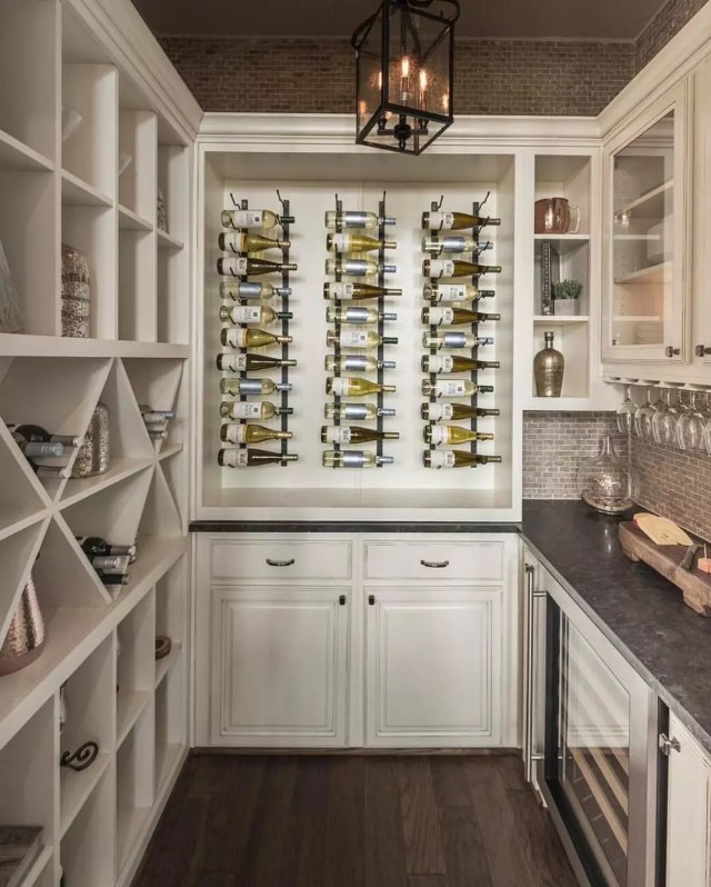 Wine Bottles Stored on the Wall of the Kitchen. Photo by Instagram user @creativehousedesigninterior