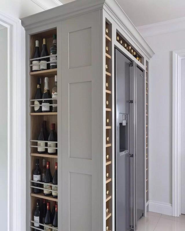 Wine Bottles Stored Alongside and Above Refrigerator. Photo by Instagram user @charliekinghamcabinetmakers