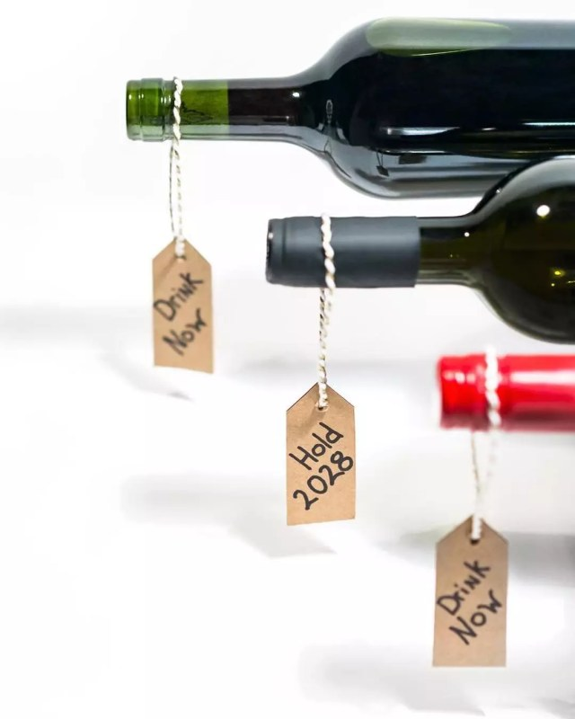 Wine Bottles with Tags to Indicate When to Drink. Photo by Instagram user @wineenthusiast