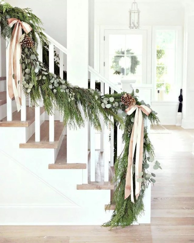 Staircase in the Front Hall Decorated with Green Garland. Photo by Instagram user @brookside_nursery