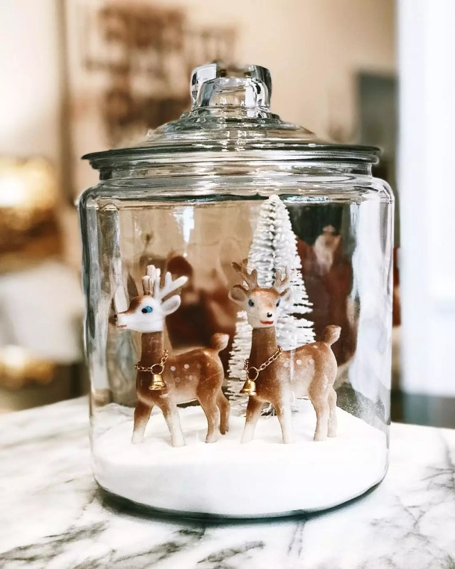 Homemade Snow Globe Made out of a Glass Jar with Toy Deer Inside. Photo by Instagram user @farmhousepeachco