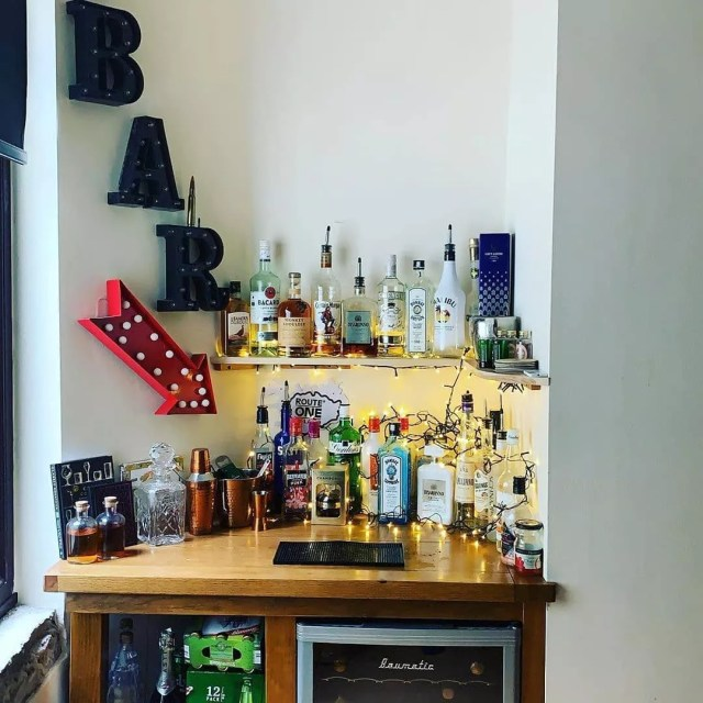 Home Bar with Fridge Stocked with Liquor and Beer. Photo by Instagram user @cocktailcatalog