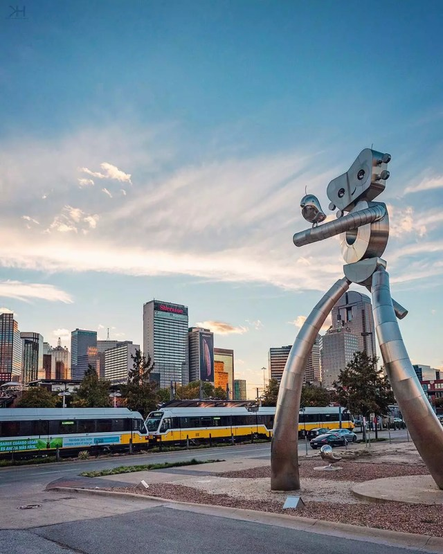 Large metal sculpture with train and Fort Worth skyline in background Photo by Instagram user @kevinhannphoto