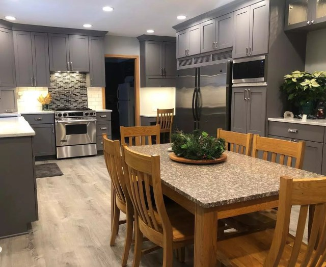 Kitchen with dark gray cabinets. Photo by Instagram user @seanscabinetry