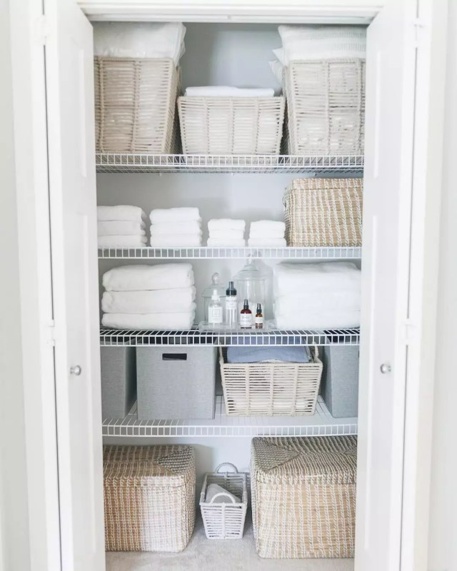 Organized bathroom closet. Photo by Instagram user @lauramayinteriors