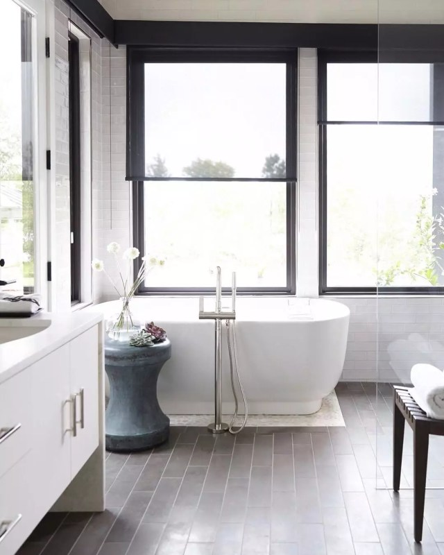 Neutral bathroom with gray tile. Photo by Instagram user @barbourspangle