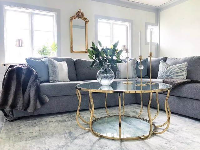 Living room coffee table with gold accents. Photo by Instagram user @sjogardsvillan