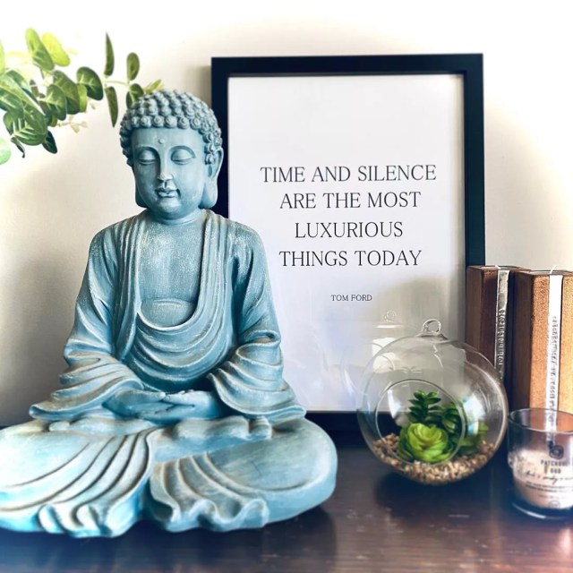 Buddha statue, framed print, and succulent. Photo by Instagram user @foreverhouseandhome